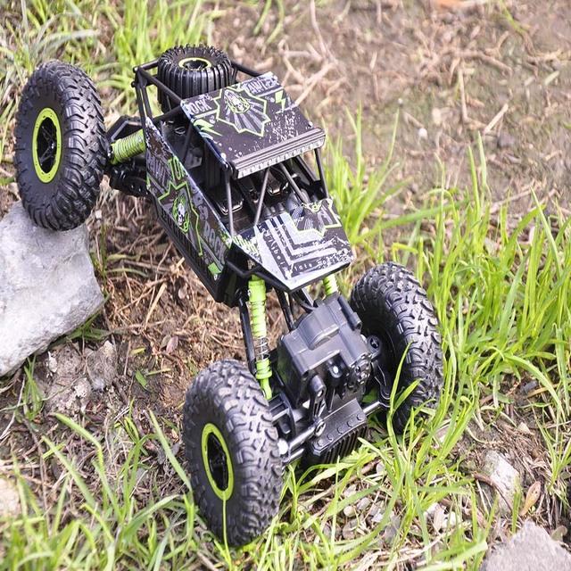 RC Coche 2.4G 4CH 4WD Rastreadores de Rock 4x4 Conducción de Coches de Doble motores de Accionamiento Bigfoot Modelo de Vehículo Off-Road Coche de Control Remoto de Coches de Juguete