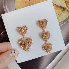 Женские серьги подвески с кристаллами асимметричные в форме