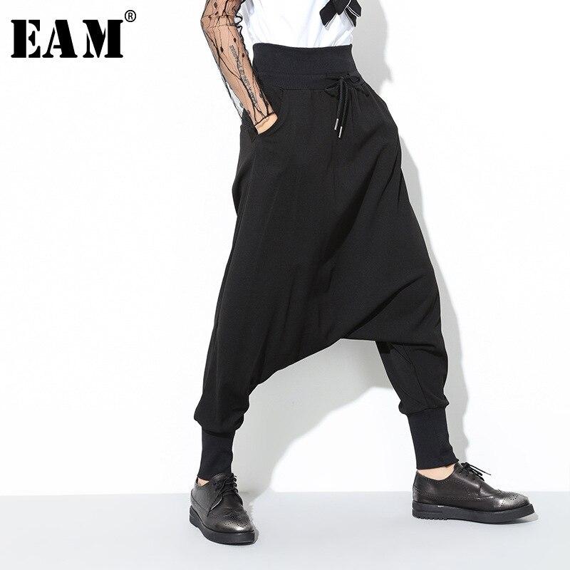 [EAM 2019 nueva moda de primavera negro sólido lazo Causal bolsillos suelto, de gran tamaño de las mujeres de cintura alta pantalones de harén RA224