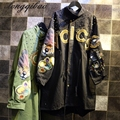 The new European and American women 's long jacket rivets long handsome long windbreaker jacket