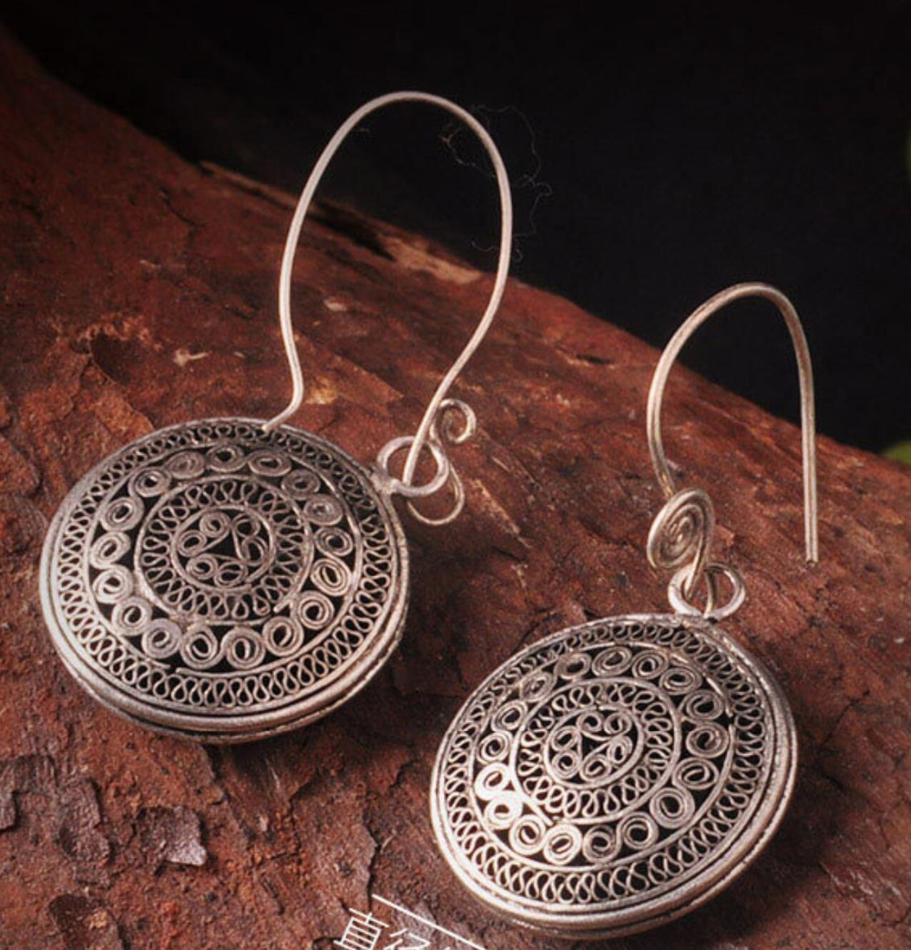Hot New Whole Handmade Hollow Filigree Earrings Vintage Antique Silver Round Bronze Personality Seedlings