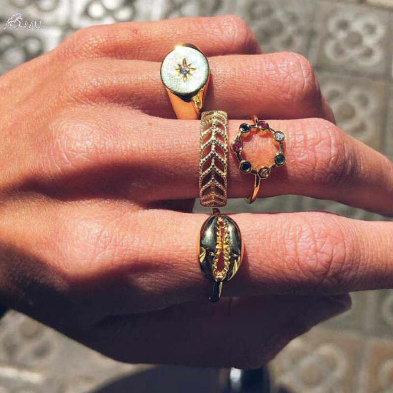 AOMU 4pcs/set 2019 Summer New Carved Hollow Compass Colorful Rhinestone Shell Gold Rings For Women Bohemian Jewelry Set