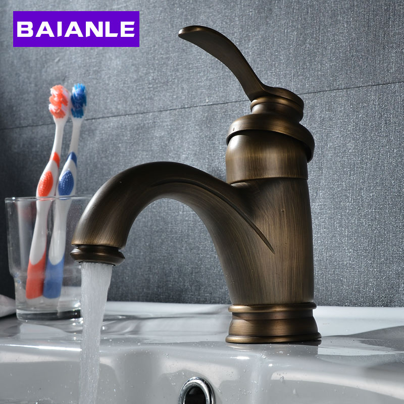 цена на Free Shipping Antique Brass Bathroom Sink Faucet Deck Mounted Hot and Cold Water Basin Tap