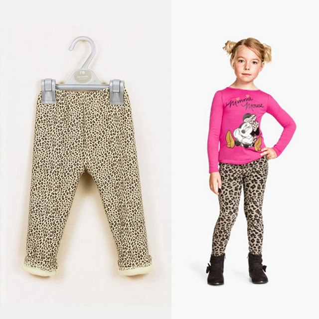 Mix and match a leopard-spotted sweatshirt and solid leggings for cute and cozy play-time style. Sweatshirt has kangaroo pocket; leggings have elastic waist Sweatshirt is 59% cotton, 41% rayon; leggings are 53% cotton, 40% modal, 7% spandex Machine wash, tumble dry Imported Kids' Wear.