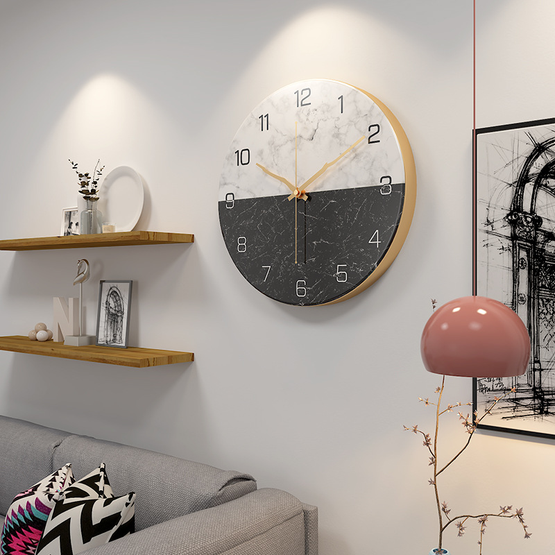 nordic wall clock above couch