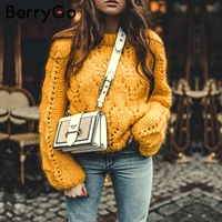 BerryGo Hollow out knitting winter sweater female O ncek lantern sleeve pull femme pollover 2018 casual loose trico women jumper