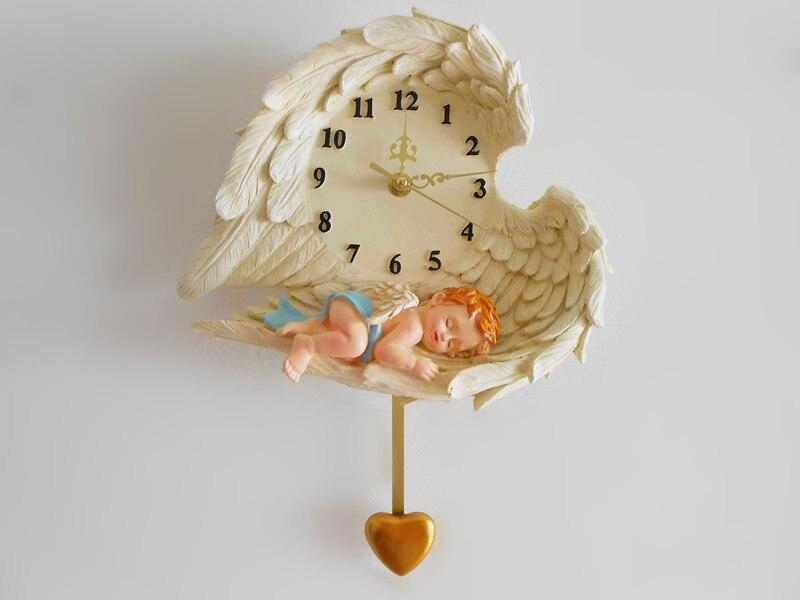 Horloge murale en résine de cour européenne haut de gamme horloge murale de salon belle ange