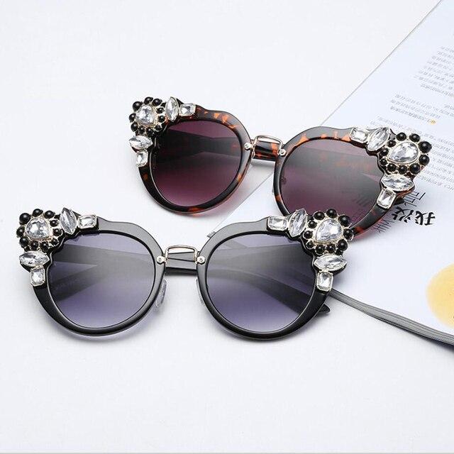 Wanita Hias berlian trend fashion cat eye sunglasses wanita kepribadian  jalan menembak oval kacamata matahari 2018 0c4f8179d4