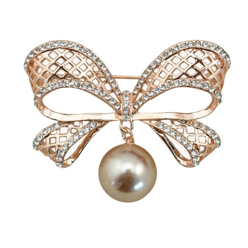 ae9061593561 Metal hueco bowknot Crystal rhinestone broche Pasadores con gota perla  mujeres Garment moda joyería