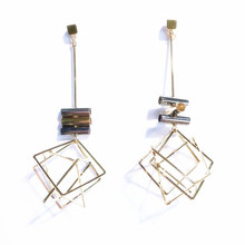 Hollow-out earrings with long studs make them slim, delicate and simple