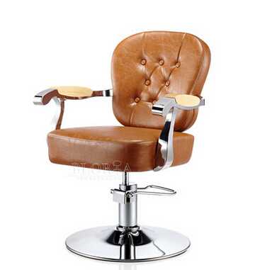 Luxury european-style hairdressing chair. Retro hairdressing chair. Special hair salons haircut chair