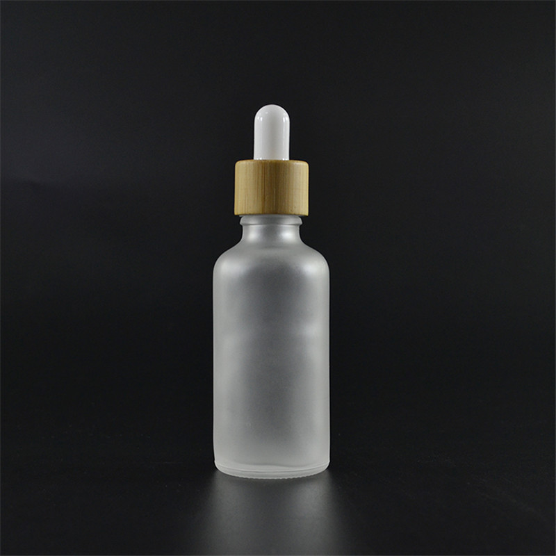 100pcs 50ml frosted clear glass bottle with bamboo dropper serum glass essential oil bottle glass dropper bottle with bamboo cap