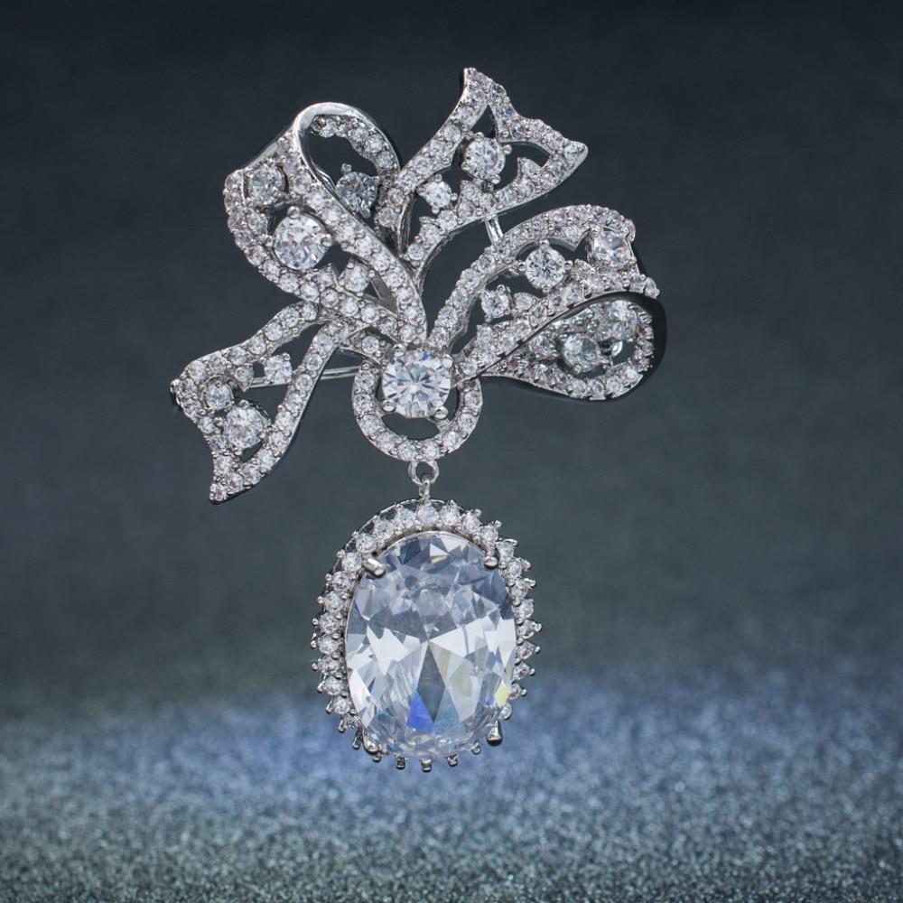 5A Cubic Zirconia Silver Tone Bowknot Dangle Brooch Broach Pin High Quality Women Jewelry Dress Accessories B0074SIL