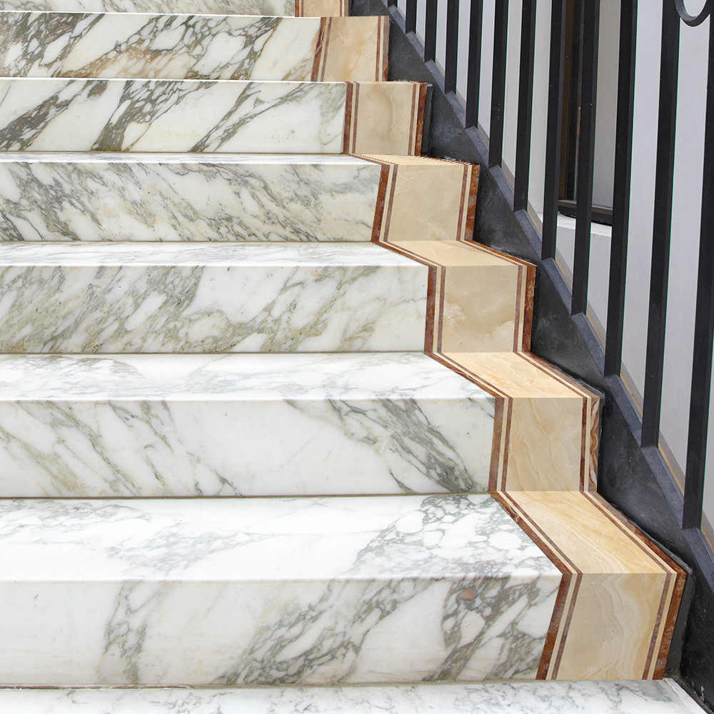 Self-adhesive marble wallpaper on staircase.