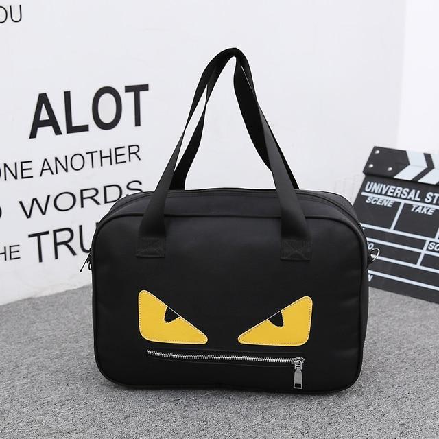 8f4bf8dc3c 2017 New Women Handbag Portable Men Lady Oxford Cartoon Yellow Eyes  Waterproof Travel Bags Luggage Duffle