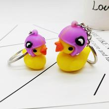 1pair Wearing a helmet duckling keychain 3D stereo PVC cartoon elephant bag pendant key ring small yellow duck chain