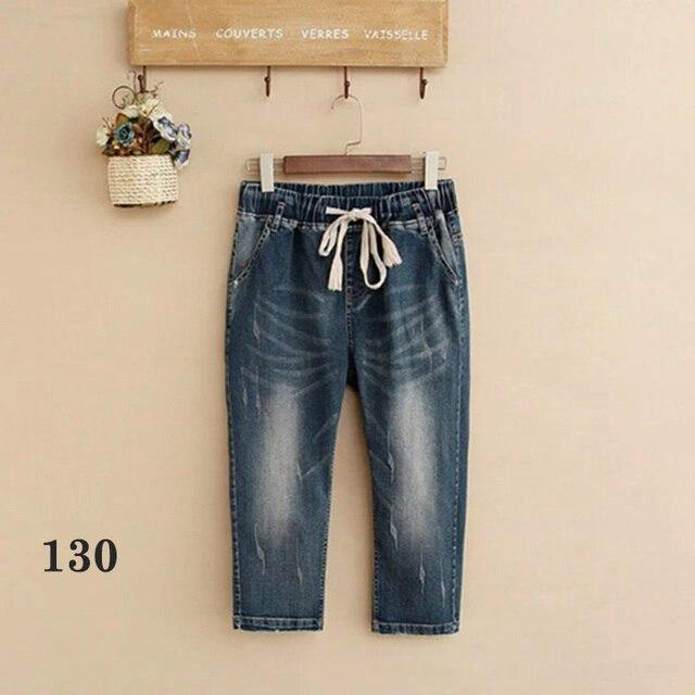 a45c8bcfcde54 XUANCHURANWEN Womens Plus Size Capris Ripped Jeans For Women High Waist Jeans  Pants Rivet Summer Stretch Denim Trousers HN01
