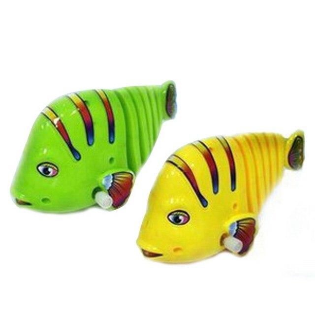 Plástico bebé juguetes mecánicos lindos conejo cola de pescado ...