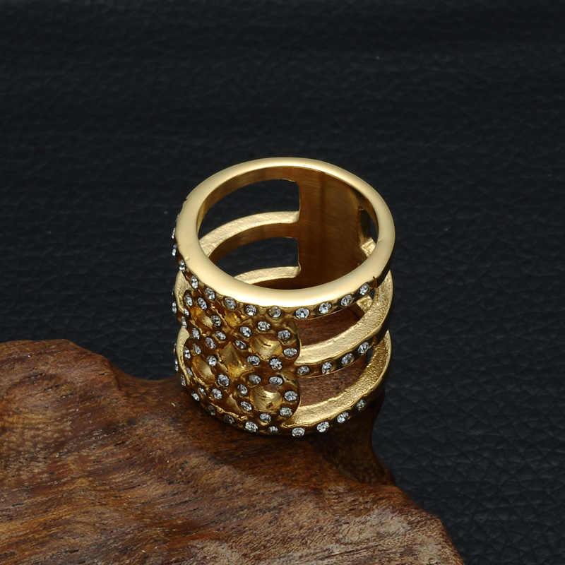 HIP Hop Bling Iced Out คริสตัลแหวนทองสี Hollow ไทเทเนียมสแตนเลสรักแหวนสำหรับเครื่องประดับสตรี