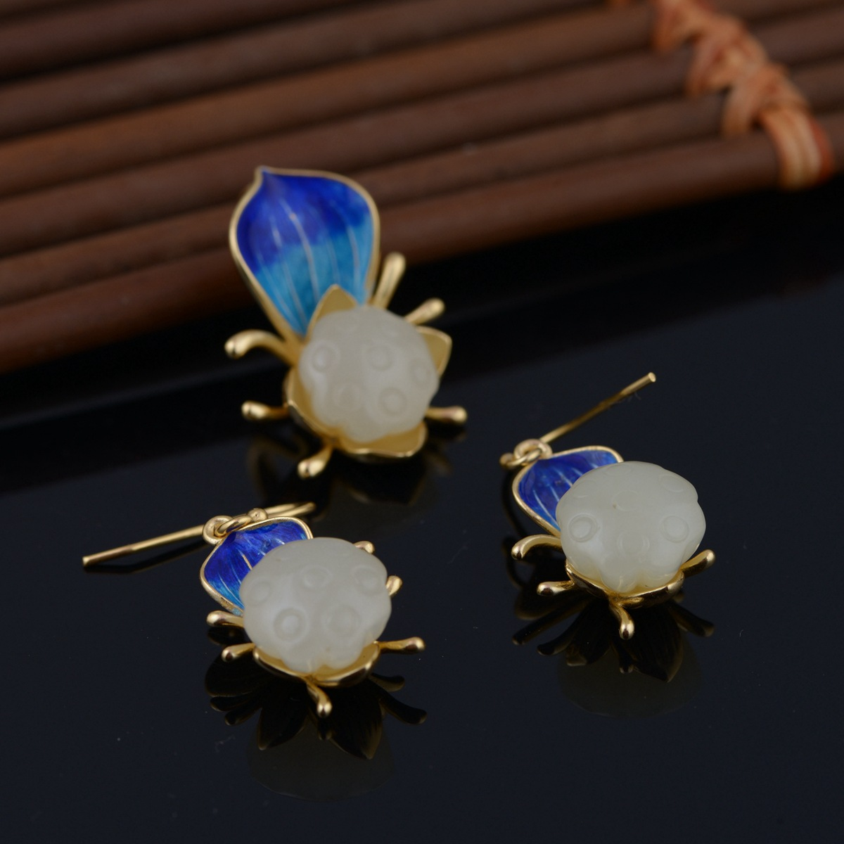 Hetian jade pendant Mana burn Thai silver wholesale S925 pure silver inlay earrings Delicate female money gifts