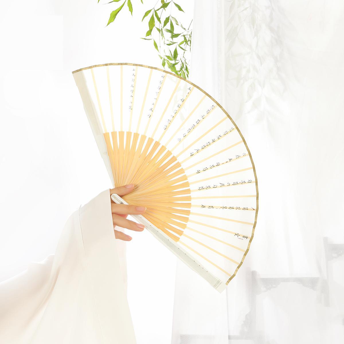 Cité interdite brise dans la brise, il semble y avoir vallée vide non voix-Guqin ventilateur os vent chinois pliant