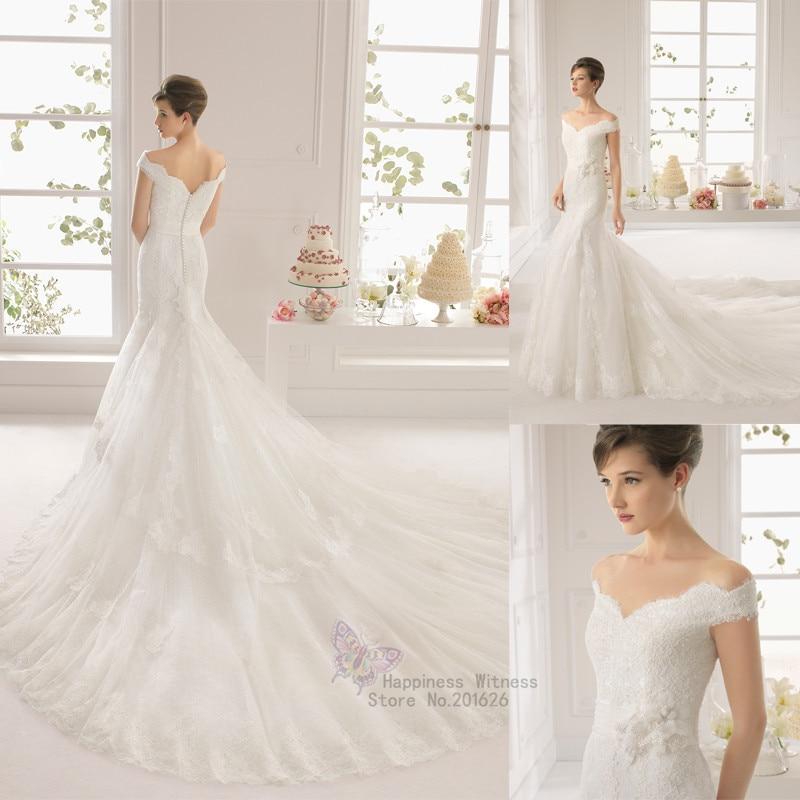 Belle robe de mariee avec manche