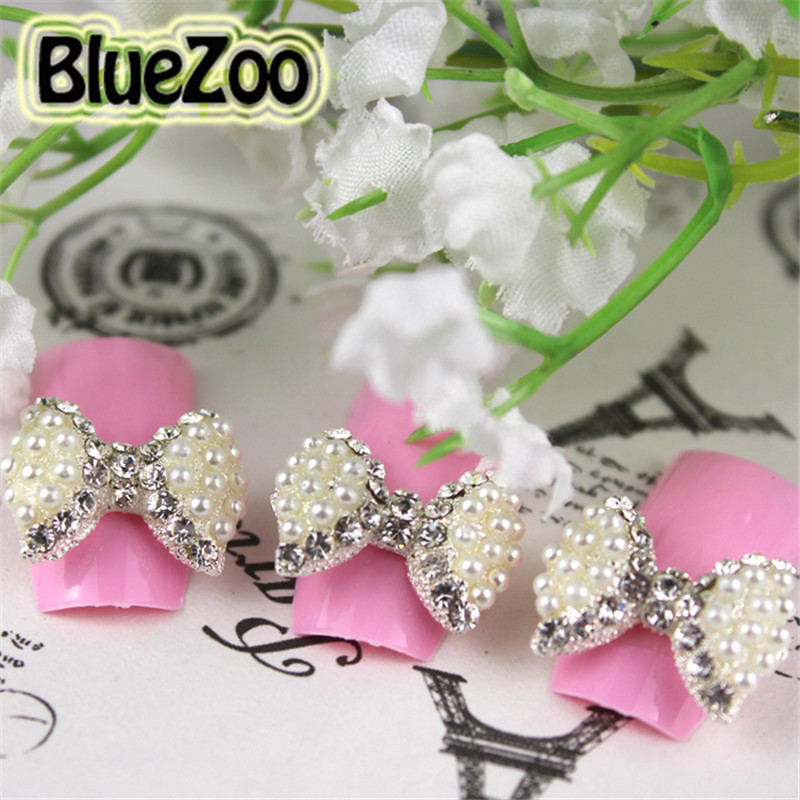 ФОТО BlueZoo Wholesales 100pcs/pack Clear Rhinestones With White Pearls Big Bow Tie 3D Nail Art Alloy Decoration Nail Stud DIY Tips