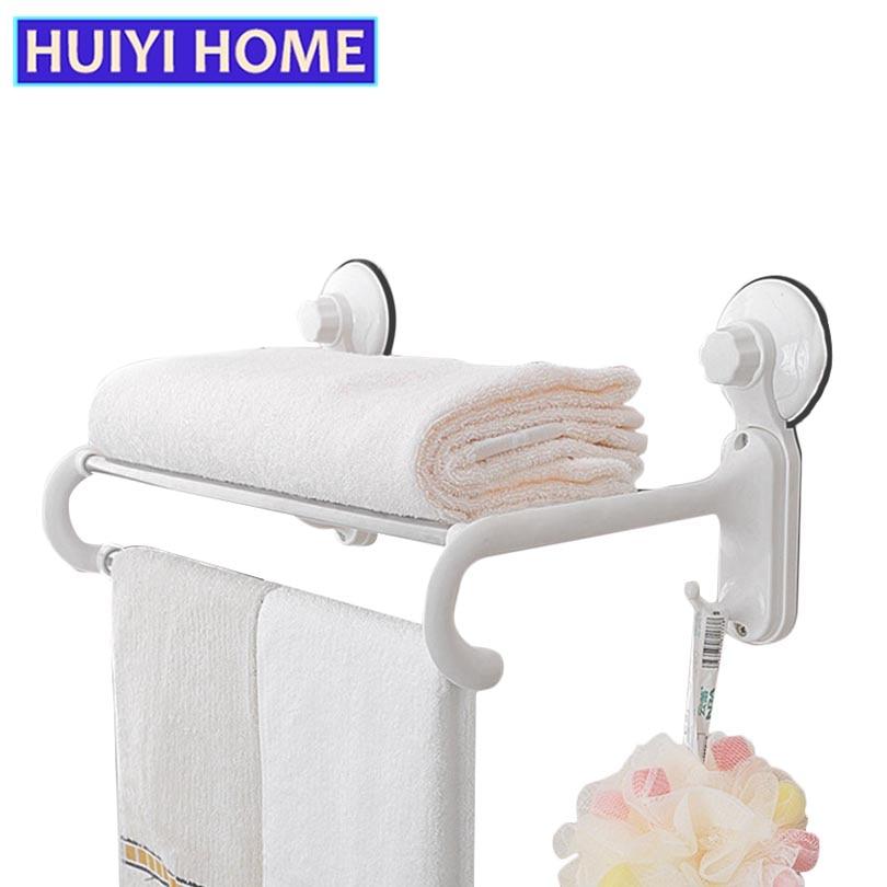 Ванна для рушників з білими гачками - Організація і зберігання в будинку