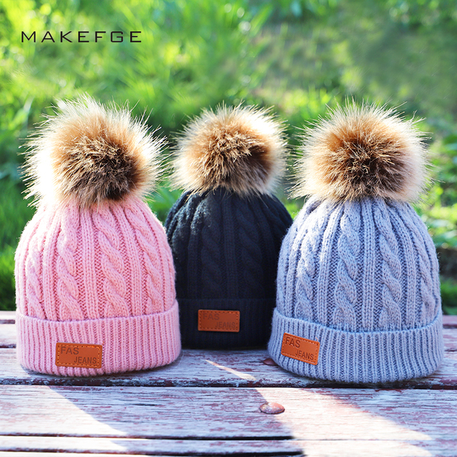 fb21a67822a Children s autumn and winter knitted cotton hats warm and comfortable ski  hat solid color fashion boy girl universal pompom caps