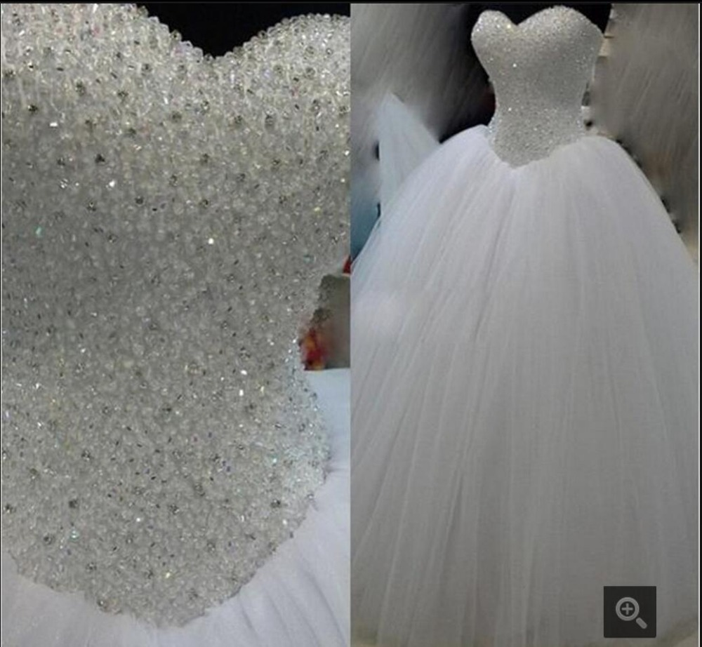 2016 New Design Ball Gown Heavily Beading Wedding Dress Strapless Sweetheart Neck Puffy Sparkly Gowns Best Ing In Dresses From Weddings