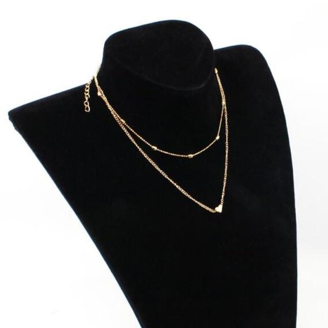 Фото женское двухъярусное ожерелье брендовое с двойным рогатым сердцем