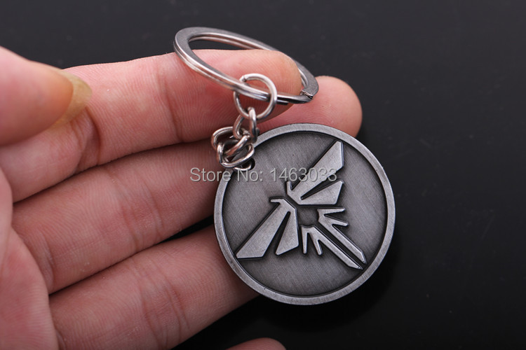 1pcs fan piece art the last of us riley abel firefly charm 1pcs fan piece art the last of us riley abel firefly charm gunmetal keychain 32mm in key chains from jewelry accessories on aliexpress alibaba aloadofball Image collections
