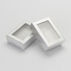 Image 1 - Caja expositora de joyería de 7x9 cm, 60 unids/lote, caja de regalo para pendientes de collar de cartón plateado, Cajas de Regalo de embalaje con esponja blanca