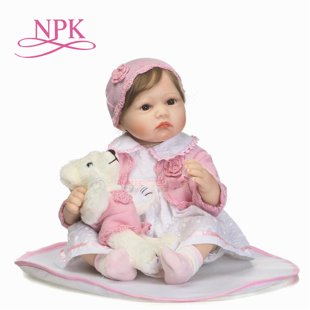 NPK 22 silicone limbs and cloth body doll lovely newborn baby girl with new Fiber hair best children gifts reborn dollsNPK 22 silicone limbs and cloth body doll lovely newborn baby girl with new Fiber hair best children gifts reborn dolls