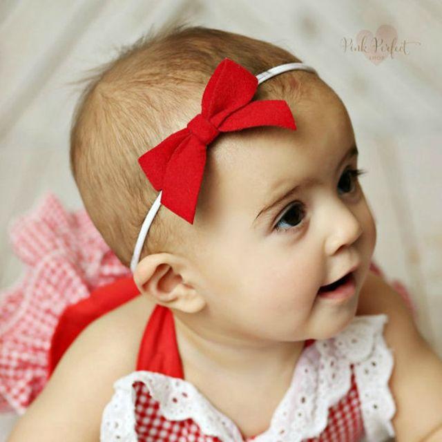 Afbeeldingsresultaat voor baby met strikje op voorhoofd