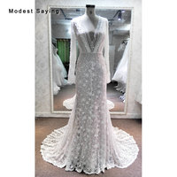 Fashion Luxury Mermaid Beaded Lace Wedding Dresses 2018 with V Neckline Sexy Backless Long Sleeves Bridal Gowns with Nude Lining