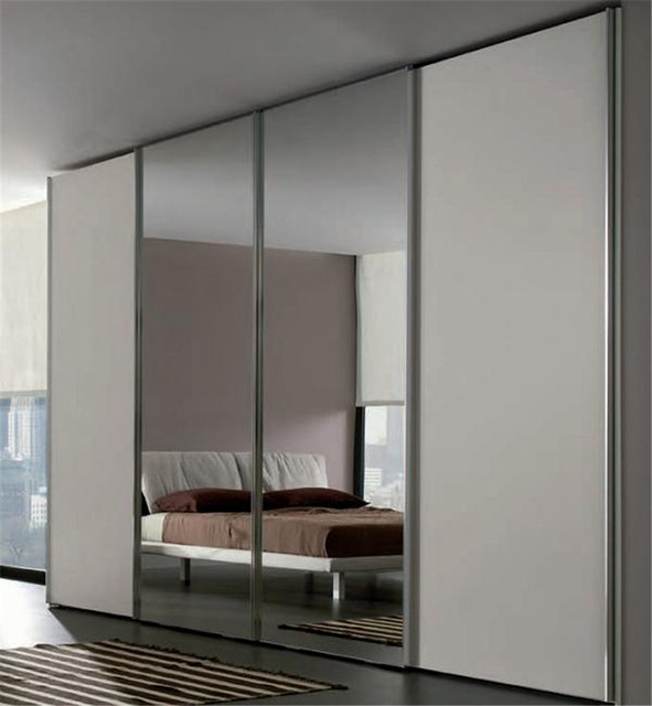 Sliding bedroom wardrobe with mirror in center in Wardrobes from