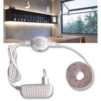 Luces LED bajo armario con Sensor de movimiento Luz de armario tira LED 12V armario impermeable armario cama lámpara 220 fuente de alimentación de la UE