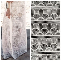 New fashion high quality off white hollow on net yarn embroidery lace fabric stage dress/party dress lace fabric by yard