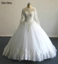 2017 Ball Gown Wedding Dresses with Scoop Neckline Long Sleeves Appliques Floor Length Sweep Train Custom Bridal Gowns