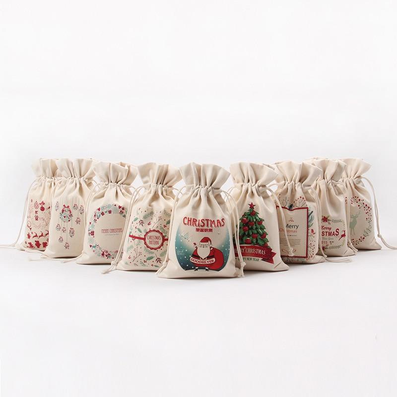 5125770d420a4 50 قطعة الوحدة عيد هدية أكياس قماش كبيرة سانتا كيس 14 نمط قماش الرباط حقيبة  2017 جديد كاندي تغليف أكياس التخزين