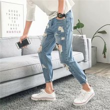 Men's jeans 2019 summer trend feet jeans hole solid color denim shorts personality fashion locomotive wild men's clothing modish solid color hole design narrow feet jeans for men