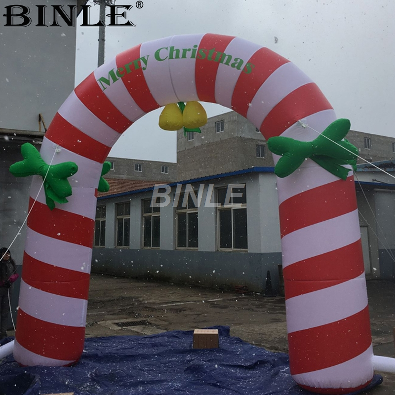 Custom red and white strips promotional Oxford event christmas inflatable archway arch gate for outdoor decoration air shipping christmas archway airblown animated inflatable gingerbread house with led lights for yard decoration