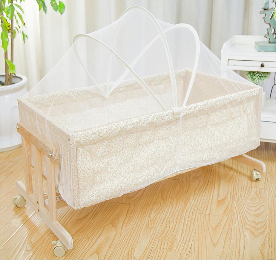 цены  Pine wood crib multifunctional environmental protection paint children cradle newborn baby bed with mosquito With wheels HC1001