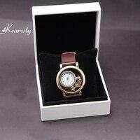 Keamsty Cinturón marrón reloj de cuarzo de acero inoxidable Locket pulsera con flotante Amuletos y caja de regalo