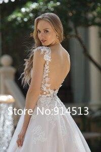 Image 2 - エレガントな A ラインチュールのウェディングドレスキャップスリーブブライダルドレスレースのアップリケ花嫁のドレス Vestido デ Noiva