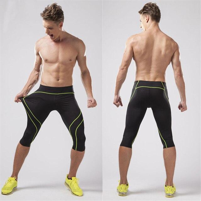 Compresión Pantalones de correr hombres 3 4 jogging Pantalones gimnasio ropa  deportiva Medias fitness legging 5de98926b9220