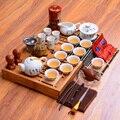 中国の伝統的な徳化白の磁器の茶セットセラミックカンフー完全なセット木製茶トレイ茶道