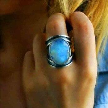60e179724070 JUNXIN Boho mujer óvalo piedra lunar anillos grandes para hombres mujeres  plata antigua Metal Arco Iris Piedra Negro epoxi anillo claro ópalo ...