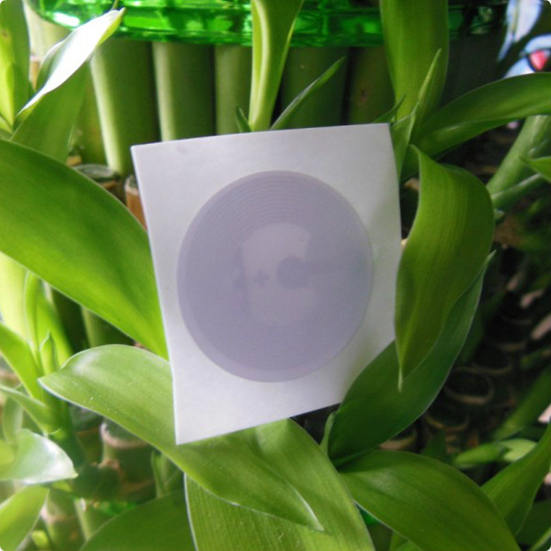 imágenes para 100 unids NTAG215 ETIQUETA NFC NFC Forum Tipo 2 Etiqueta de Alto Rendimiento Con Película Protectora de Plástico NTAG215 NFC Pegatinas Dia.25mm